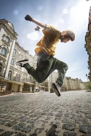Dancer hip-hop in town street photo