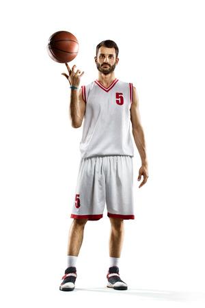 白で隔離のバスケット ボール選手 写真素材