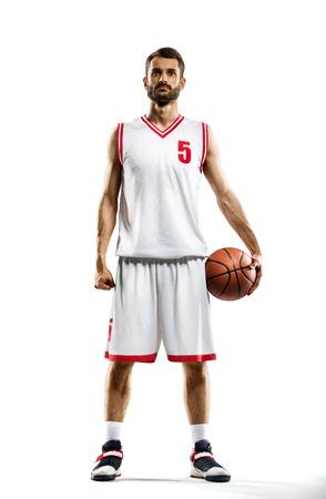 Basketbalspeler op wit wordt geïsoleerd Stockfoto