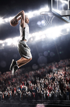 scoring: Basketball player in action flying high and scoring Stock Photo