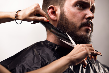 cutting hair: Beard trimming Stock Photo