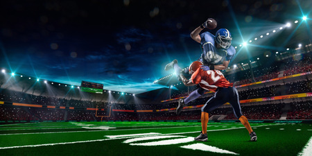 American football player in action on the stadium