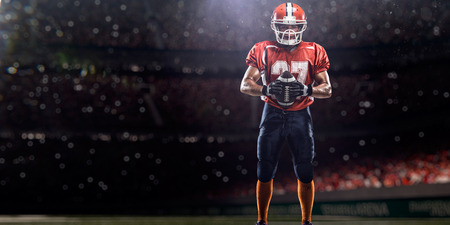 stadium lights: American football sportsman player in stadium
