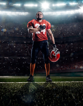 american football ball: Proud american football player is praying  before match