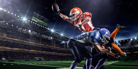 footballs: American football player in action on the stadium