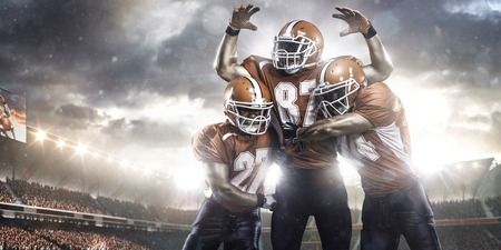 touchdown: American football players in action on the stadium Stock Photo