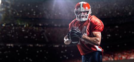 footballs: American football sportsman player in olympic stadium