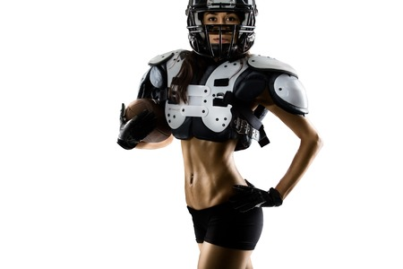 women playing soccer: Female american football players isolated on white background Stock Photo