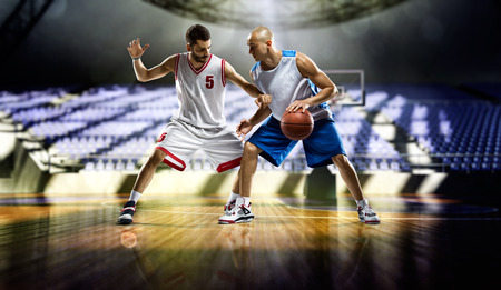 Two basketball players action in the city gym