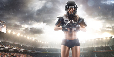 women playing soccer: American football female player posing with ball