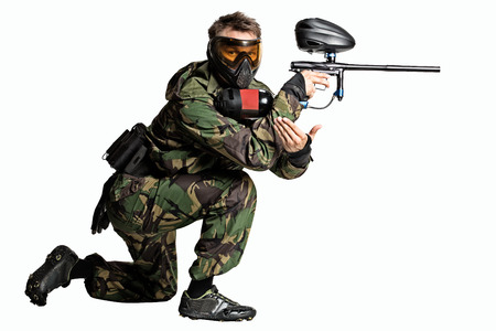 Isolated on white painball player in action photo