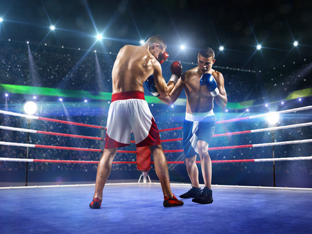 boxing match: Two professionl boxers are fighting on the grand arena
