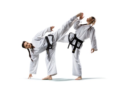 Two isolated professional female karate fighters are fighting on the grand arena Stock Photo