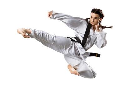 cerillos: Profesional karateca femenino aislado en el fondo blanco
