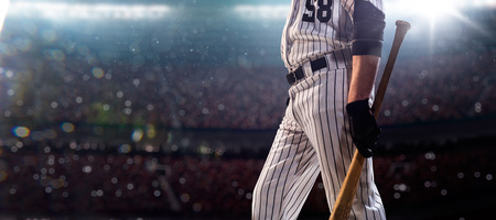 baseball dugout: Professional baseball player in action on grand arena