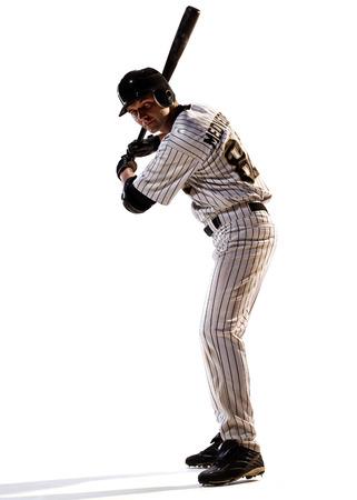 アクションで白いプロ野球プレーヤーの分離 写真素材
