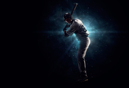 sit studio: Professional baseball player  is tanding in the spotlight