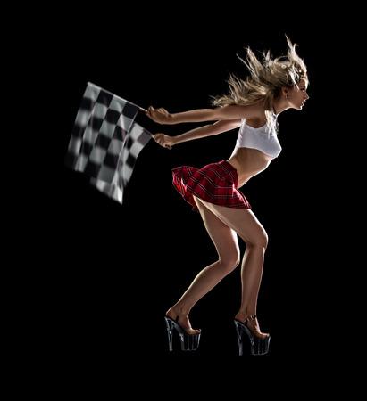 Geïsoleerde jonge sexy meisje begint de nacht drag race Stockfoto