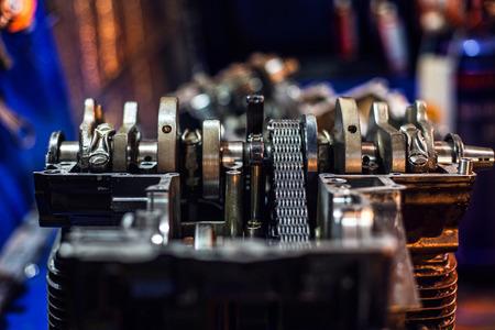 dismounted: Completely disassembled sport motorcycle engine block crankshaft