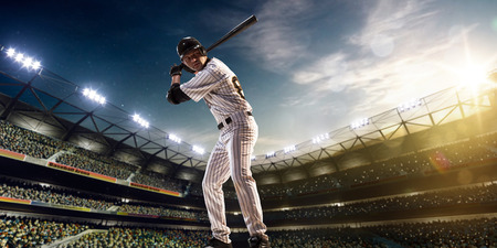 adults only: Professional baseball player in action on grand arena