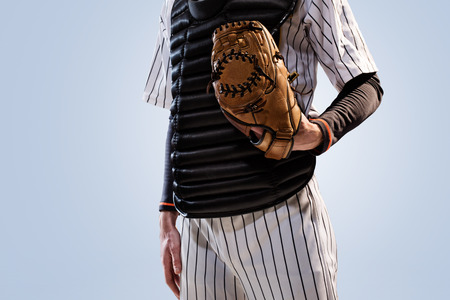 baseball player: isolated on white professional baseball player in action Stock Photo