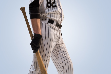 dugout: isolated on white professional baseball player in action Stock Photo