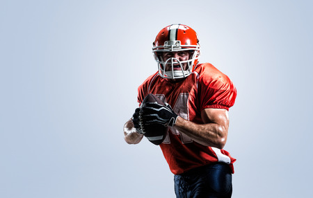 american football player: American football player in action white on isolated Stock Photo