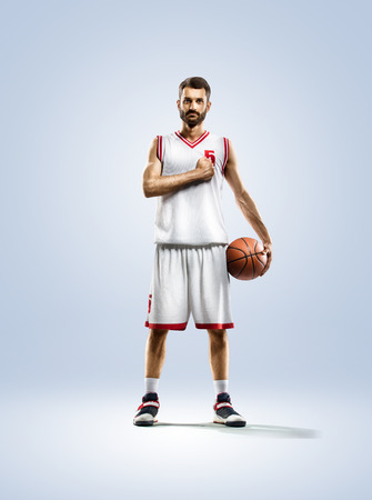 Basketball player in action isolated on white Stok Fotoğraf