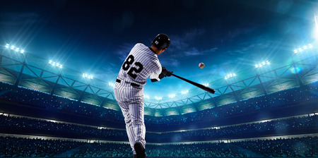 hit man: Professional baseball players on the grand arena in night