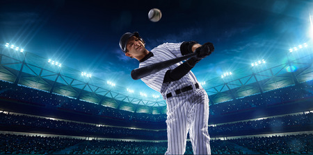 Professional baseball players on the grand arena in night photo