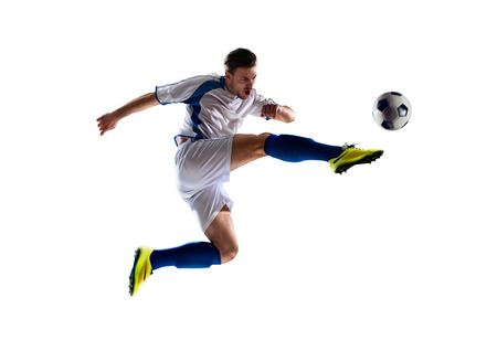 soccer kick: football soccer player in action  isolated white background