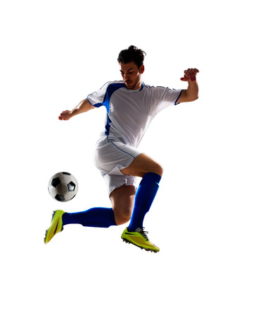 in action: jugador de fútbol de fútbol en la acción aislada de fondo blanco