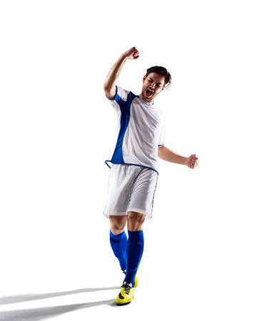 jugador de futbol: jugador de f�tbol de f�tbol en la acci�n aislada en el fondo blanco