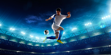 light game: Soccer player in action on night stadium background