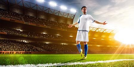 Soccer player in action on night stadium panorama background Standard-Bild