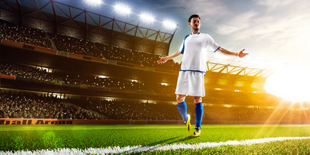 adult foot: Soccer player in action on night stadium panorama background Stock Photo
