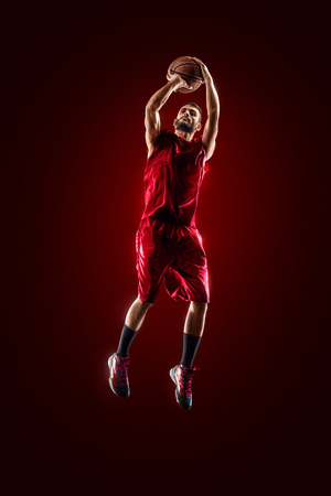 Isolated on black basketball player in action is flying high Stock Photo - 38760801