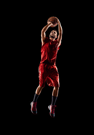 Isolated on black basketball player in action is flying high
