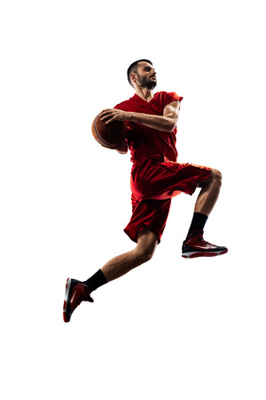 a basketball player: basketball player in action Isolated on white Stock Photo