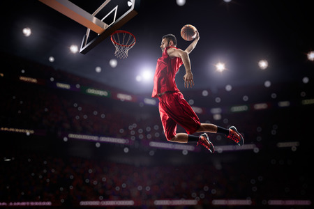 hoop: red Basketball player in action in gym Stock Photo