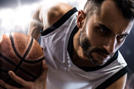 sport: basketball player in action Isolated on black
