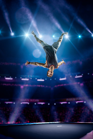 Young man is jumping on the trampoline Stock Photo