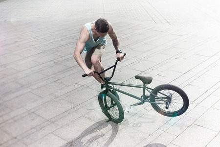 bmx: bmx bicycle rider tricking on the highlights Stock Photo
