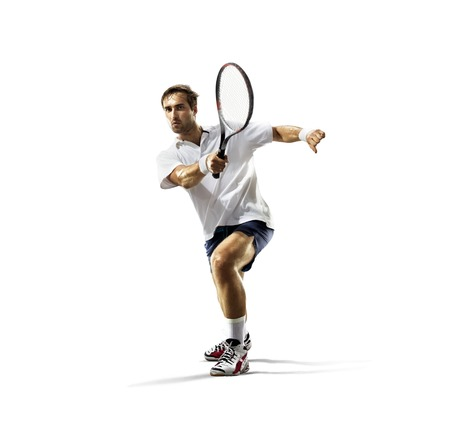 male tennis players: isolated on the white young man is playing tennis