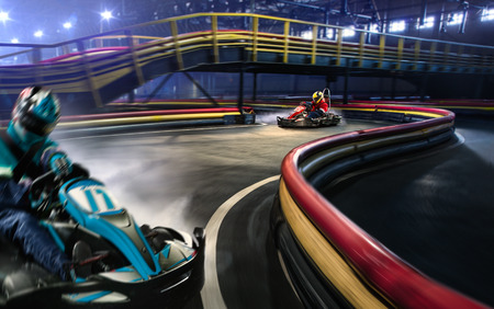 motion: Two cart racers are racing on the grand track motion