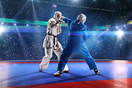 fight arena: Two kudo fighters are fighting on the grand arena blue and white
