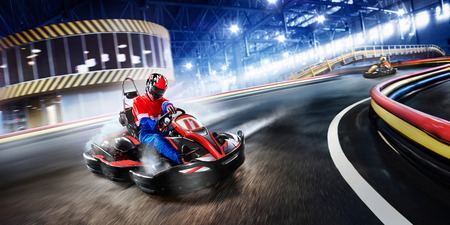 Two cart racers are racing on the grand track motion