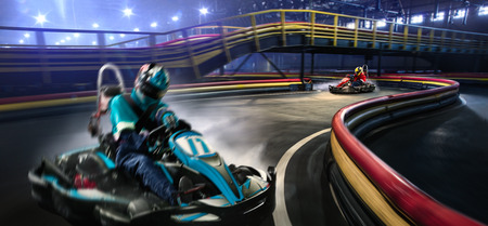 individual sport: Two cart racers are racing on the grand track motion