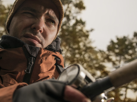 salmon fishery: Mature man is fishing  on the wild river