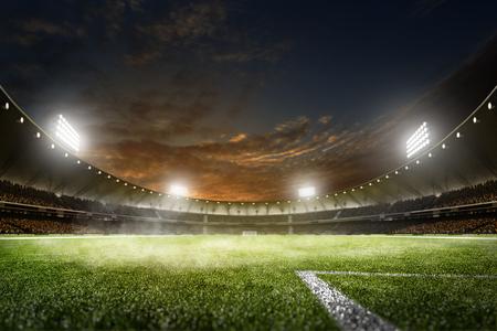 campeonato de futbol: noche vacía magnífica de la arena de fútbol en las luces Foto de archivo